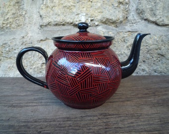 Red and black enameled tea pot