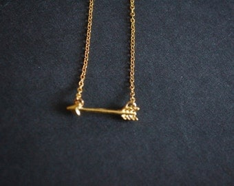 gold tone cupid's arrow necklace
