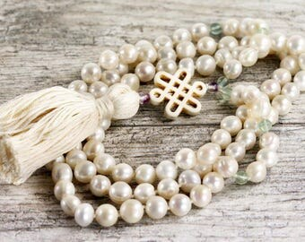 """White pearl and fluorite beads mala necklace with a Endless tibetain knot accent - 42"""" inches long"""