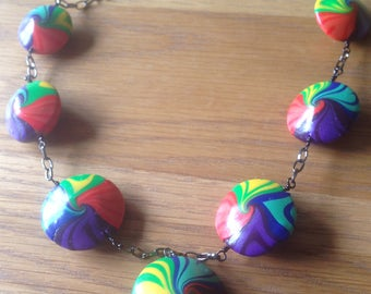 Multicoloured rainbow swirly beads on black chain, Polymer clay necklace, Bright lentil shaped beads, Rainbow coloured, Handmade clasp