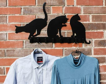 Designer clothes hanger with cats