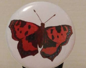 Red butterfly badge