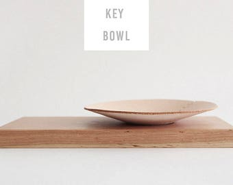 storing key bowl made by wood and leather