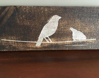 Pallet stained with white birds stenciled