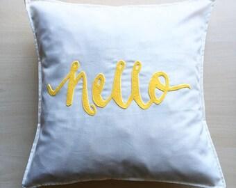 Fun yellow Hello cushion cover