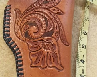 Holster,hand cut, tooled, and stiched ,