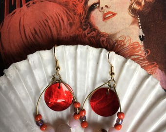 Red shell dangle earrings. Ornate,eye catching shell detail in red.
