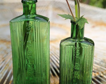 """Two poison bottles """"Not to be Taken"""" green glass with ridge detail, set of two"""