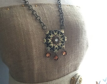 Orange and black vintage tin sun necklace
