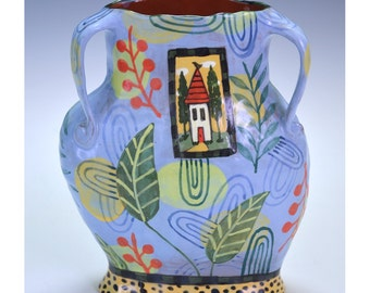 Blue vase with berries and house inset.