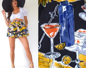 SUMMER SALE/ 30% off Vintage 80s 90s Five'o'Clock Somewhere Novelty Print High Waisted Tap Shorts (size small, medium)