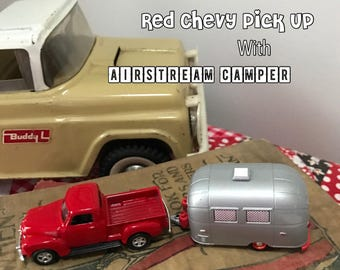 Red CHevy Pick Up pulling a Vintage Airstream Camper - Red Polka Dot Curtains, Too!