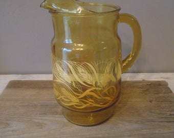 Large vintage 1970s gold glass pitcher with yellow and orange wheat pattern  / vintage kitchen serving piece / retro gold pitcher