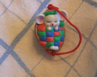 wee tiny mouse in a nut bed ornament