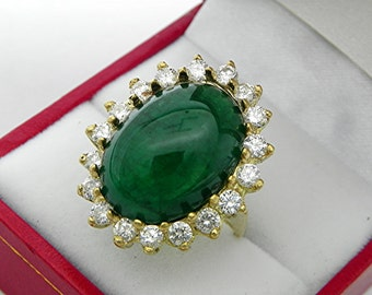 Emerald   19x14mm  15 Carats   in 18K yellow gold Diamond halo ring with 1.75 carats of Diamonds  1353