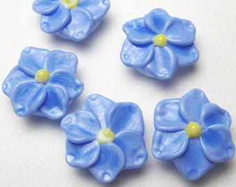 Handmade artisan lampwork Forget Me Not Beads in light periwinkle blue and lemon yellow