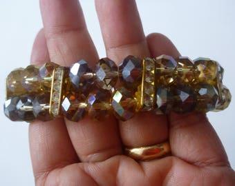 vintage ChaCha glass bead bracelet. amber bead bracelet. elastic bracelet. faceted glass bead bracelet