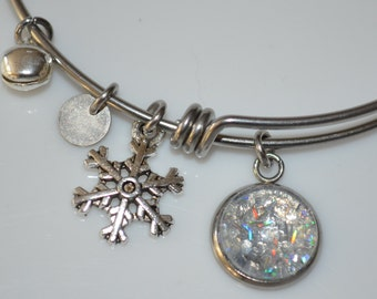 "Seasons of Maine Winter Collection featuring a bangle bracelet with charm made with fake ""snow"""