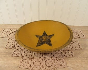 Yellow round wood painted bowl with primitive star inside and black distress accents- nice condition ready to use or display