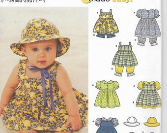 Simpliicity 9784 sewing pattern, Baby Dress, Pinafore, Pantaloons,Panties, Hat.  Size s - L  Uncut Pattern