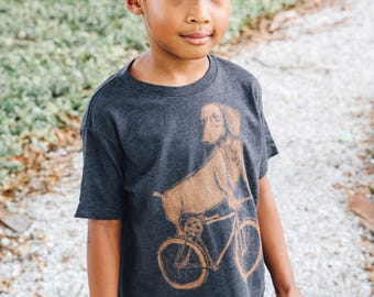Dachshund on a Bicycle- Kids T Shirt, Youth Tee, Blended Tee, Handmade graphic tee, sizes 2-12
