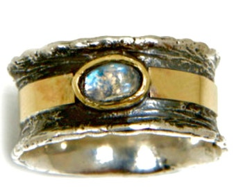 Silver Ring. Statement ring / spinner ring Sterling SILVER and 9 ct gold set   Garnet / Blue topaz / Opalןא