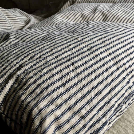 Feather Ticking mattress in loved condition.