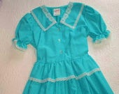Ready to Ship VINTAGE Girl's size 12 Turquoise Dress with tiny white dots and lace trimming.