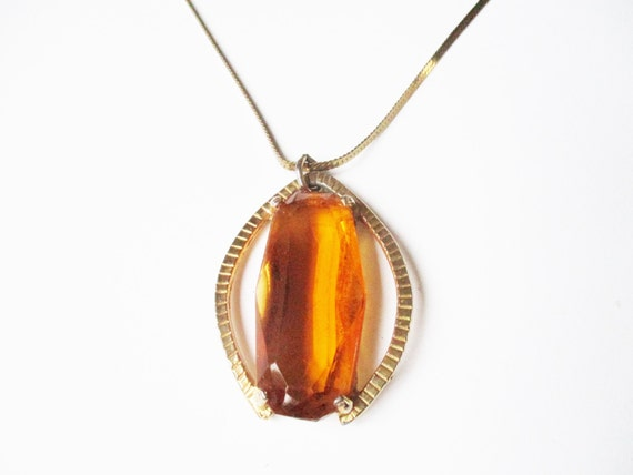 Amber glass pendant: Dramatic 1960s amber-coloured gold tone glass costume pendant necklace, 1960s geometric gold pendant necklace