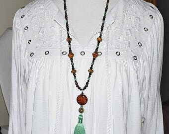 Long Beaded Necklace With Green Tassel