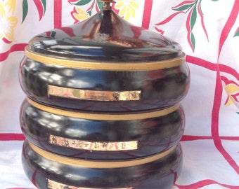 Black and gold vintage kitchen snack canister set. 3 stacking containers.  Vintage kitchen canisters. Vintage canisters.