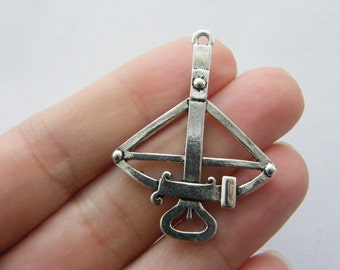 4 Crossbow charms antique silver tone G86