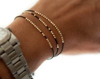 SALE items ship March 1st Silk bracelet. Disco faceted friendship bracelet in 14k solid yellow gold.  Beaded bracelet. Delicate bracelet.