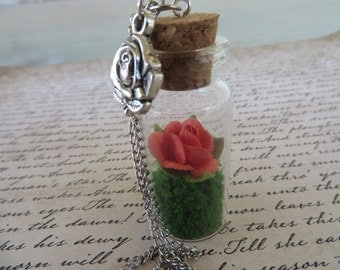 Glass Jar Pendant Necklace With Red Paper Rose And Green Foliage And Rose Charm