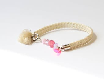 Ivory white woven silk bracelet with tassel and glass beads