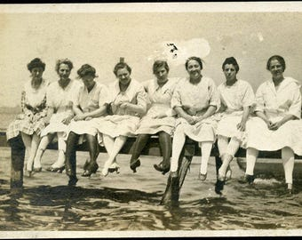 Eight GIRL FRIENDS Sitting On the Dock By The Lake In Their Cotton Dresses Photo Postcard 1918