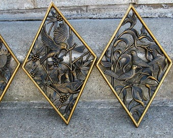 1970s black and gold wall hangings burwood birds and flowers asian decor mid century hard plastic diamond shaped