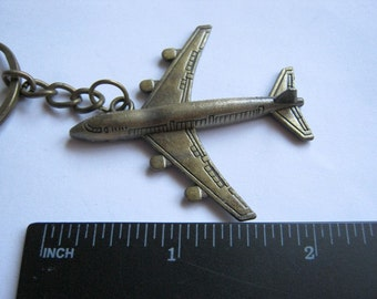 Old vintage key pendant Airplane