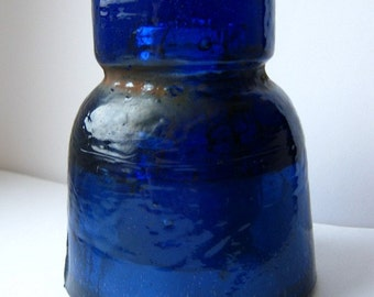 Deep cobalt blue old insulator with white inclusion