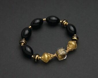 Gold Murano glass bracelet. Black and gold beaded bracelet. Venetian glass bracelet. Gold jewellery.