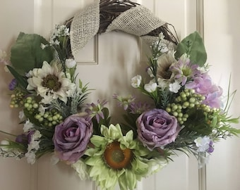 Lavender Rose- grapevine wreath wrapped in burlap with green sunflower, lavender roses and more.