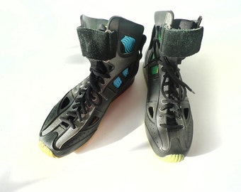 90's cutout cyber high-tops in black, glitter grey, and citrus yellow soles . size 7 US 37 EUR 5 UK