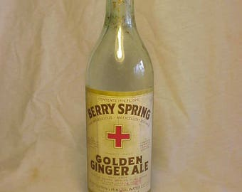 1924 Berry Spring Golden Ginger Ale Berry Spring Mineral Water Co. Pawtucket, R.I. , 16 Ounce Soda Bottle with the Paper Label