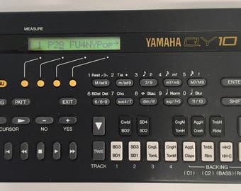Vintage Black and Yellow Yamaha QY10 Electronic Drum Machine and synthesizer mint in case