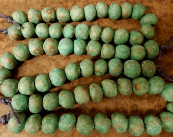 22 Hand made small round, stoneware clay beads with an ancient  earthy turquoise, …copper patina….#3788