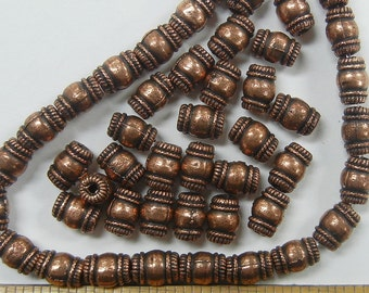 8x5mm barrel, spiral border, copper ox plated beads. 25 piece lot, (CPM-7)