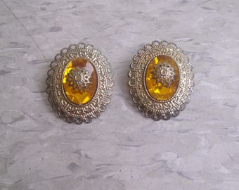 vintage clip earrings goldtone yellow lucite center