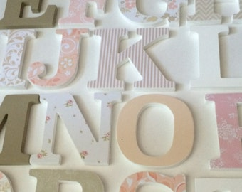 Alphabet set in peach, white and tan