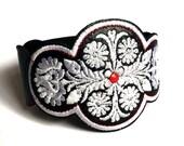 Embroidered arm bracelet with Hungarian folk motive