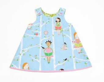 pink blue reversible baby a-line dress, blue pink girls pinafore dress, baby girl dress with snaps, girls on a swing, book reading girls